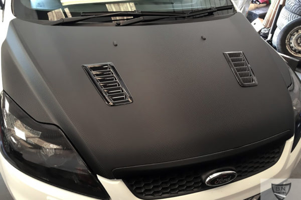 Gallery image shows front car matte wrapping by B.N.Window Tinting & Car Wrapping